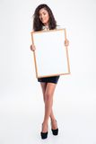 Cheerful busineswoman holding blank board Stock Photos