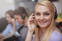 Cheerful call center operator at work stock photos