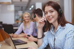 Cheerful call center operator at work royalty free stock photo