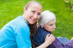 Cheerful carer with patient outdoor Royalty Free Stock Photos