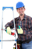 Cheerful carpenter showing thumbs up Royalty Free Stock Photography