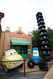 Cheerful cartoon cars. Smiling cars at an amusement park waiting for guests Royalty Free Stock Image