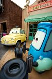 Cheerful cartoon cars. Smiling cars at an amusement park waiting for guests Royalty Free Stock Photo