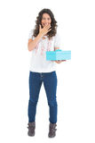 Cheerful casual brunette receiving a present Stock Photos