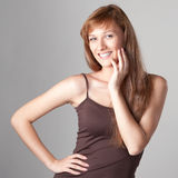Cheerful casual girl on gray Stock Photos