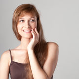 Cheerful casual girl on gray Royalty Free Stock Images
