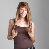 Cheerful casual girl on gray Stock Images