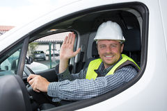 Cheerful casual guy smiling happily showing thumbs up sitting in a big white car Stock Photo