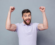 Cheerful casual man celebrating his success Stock Photography