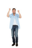 Cheerful casual man cheering Royalty Free Stock Image