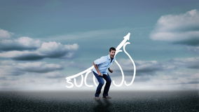 Cheerful casual man jumping in front of success graphic stock footage