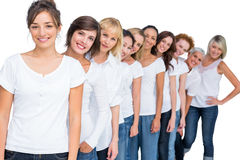 Cheerful casual models posing in a line looking at camera Royalty Free Stock Photos