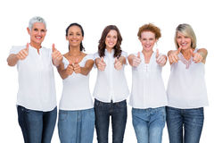 Cheerful casual models posing together with thumbs up Royalty Free Stock Images