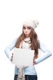 Cheerful casual winter girl holding sign Royalty Free Stock Photo
