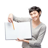 Cheerful casual woman pointing at empty open book Stock Images