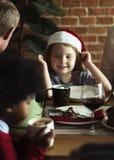 Cheerful caucasian girl wearing a Santa hat Royalty Free Stock Photos