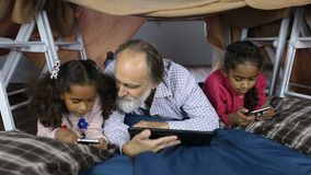 Multi-ethnic family using technology gadgets stock video