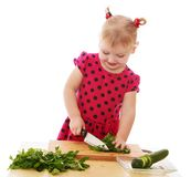 Cheerful caucasian little girl with a knife cut Stock Image