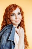 Cheerful caucasian pretty woman wearing denim jacket royalty free stock images