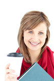 Cheerful caucasian woman holding a book and coffee Stock Photos