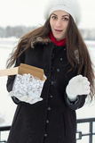 Cheerful Caucasian Young Woman in Snowy Weather is surprised to Stock Photos