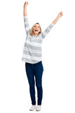 Cheerful celebration woman. Happy young woman celebrating with cheer and smile on white background Royalty Free Stock Photo