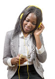 Cheerful charming African girl holding mobile phone and listeni Stock Images