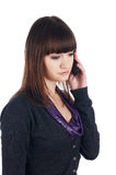 The cheerful charming brunette female with pone Stock Photo