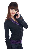 The cheerful charming brunette female with pone Stock Image