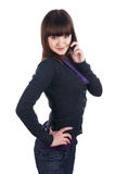 The cheerful charming brunette female with pone Royalty Free Stock Photography