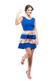 Cheerful charming cute woman in blue dress waving hand at camera. Full body length portrait isolated on white studio background Stock Images