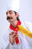 Cheerful Chef. Smiling and using spaghetti like a musical instrument Stock Images