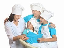 Cheerful chef with assistants. Cheerful female chef with assistants isolated on white background stock photo