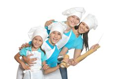 Cheerful chef with assistants. Cheerful female chef with assistants isolated on white background stock photos