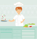 Cheerful chef cooks in the kitchen Royalty Free Stock Photography
