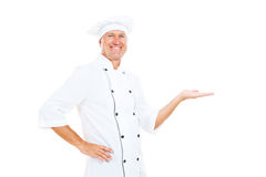 Cheerful chef holding something Stock Image