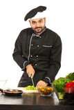 Cheerful chef working in kitchen Royalty Free Stock Image
