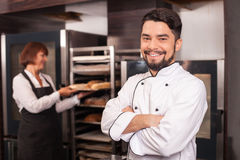 Cheerful chefs are in process of work Royalty Free Stock Image