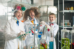 Cheerful chemists Stock Images