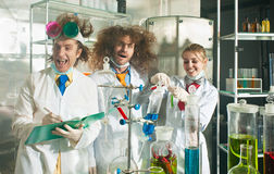 Cheerful chemists Stock Image