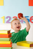 Cheerful child with apple Royalty Free Stock Photography
