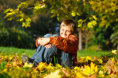 Cheerful child in autum meadow Royalty Free Stock Image