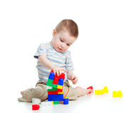 Cheerful child boy playing with construction set Royalty Free Stock Photo