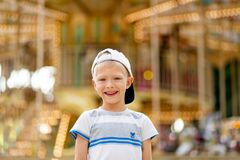 A cheerful child a boy of 5-6 years old walks in an amusement Park. Children lifestyle