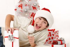 Cheerful child with Christmas gifts Royalty Free Stock Photo