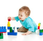 Cheerful child with construction set over white Royalty Free Stock Photo
