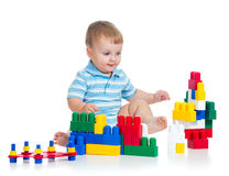 Cheerful child with construction set over white Stock Image