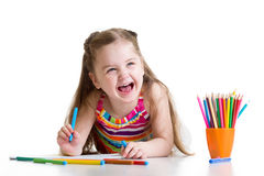 Cheerful child girl drawing with pencils in. Cheerful child little girl drawing with pencils in preschool stock photos