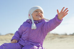 Cheerful child girl extending her hand outdoor Stock Image