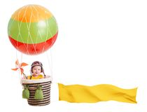 Cheerful child girl on hot air balloon isolated on Stock Photos